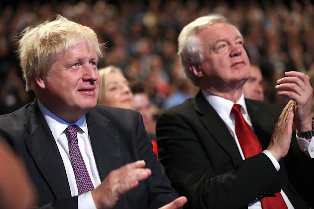 Foreign Secretary Boris Johnson and Brexit Secretary David Davis await the arrival of Prime Minister Theresa May before she delivers her keynote speech to delegates and party members on the last day of the Conservative Party Conference at Manchester Central on October 4, 2017 in Manchester, England. The prime minister rallied members and called for the party to
