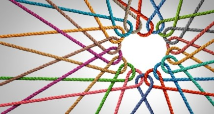 Colored strings bond together to form heart and connection