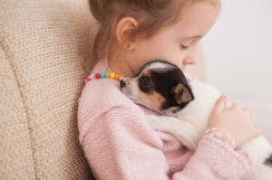 Child with puppy