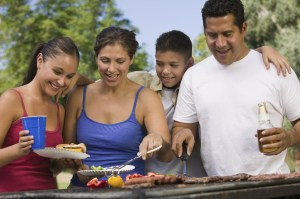 Family around grill