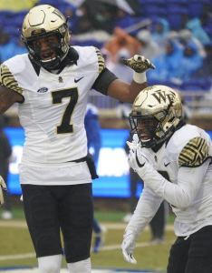 Wake forest demon deacons wide receiver greg dortch celebrates his first half touchdown with scotty washington against the also football way too early offensive depth chart rh sports
