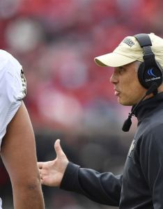 Wake forest demon deacons head coach dave clawson talks with offensive lineman nathan gilliam on the sideline during second half against also football way too early depth chart rh sports