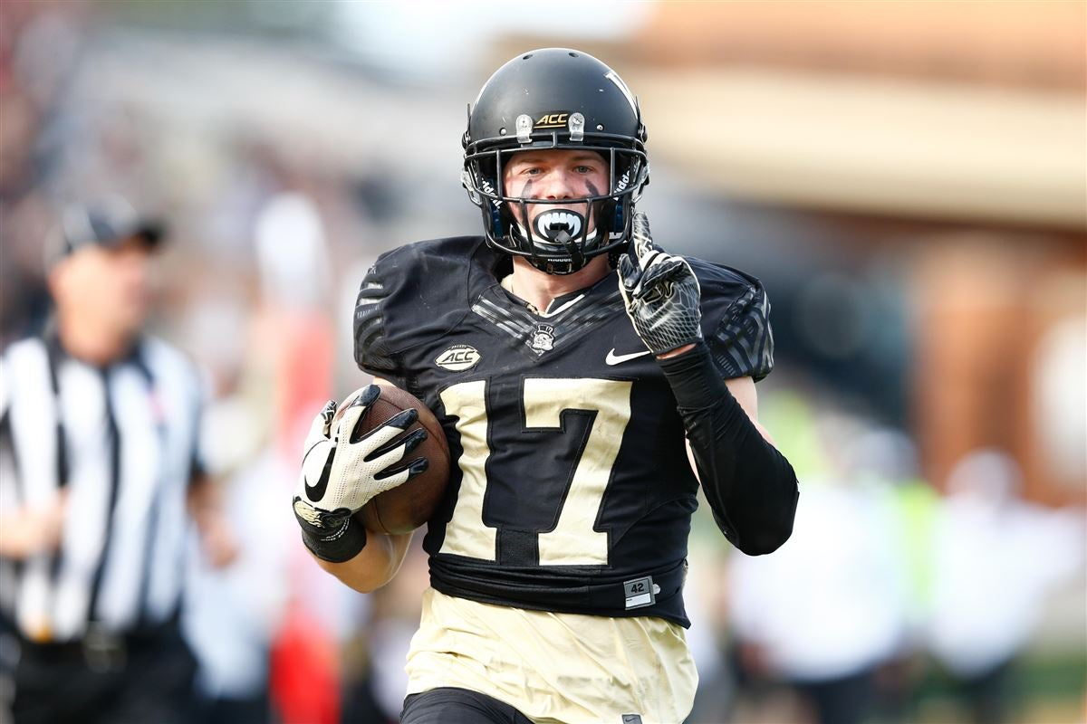 Wake forest demon deacons wide receiver alex bachman holds up  finger on the way to end zone after reception in second quarter against also football offense depth chart projections rh sports