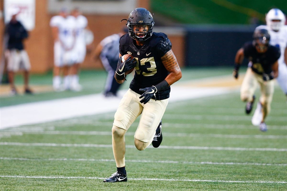 Wake forest demon deacons linebacker justin strnad intercepts  pass in the second quarter against presbyterian blue hose at bb   field also football what we ve learned fall camp so far rh sports