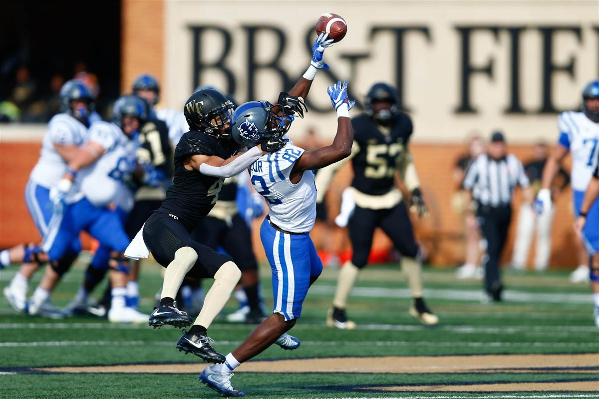 Wide receiver chris taylor attempts to catch  pass against wake forest demon deacons defensive back amari henderson in the first quarter at bb   also football top fall camp position battles rh sports