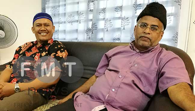 Northern region Ahmadi Community jemaat president Abdul Aziz Mohd Ibrahim (right) and fellow Ahmadi member from Indonesia, Hasnar Sriregar (left).