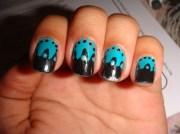 black and teal nail art