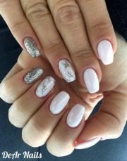 white nails and glitter flakes