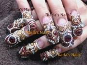 gold and garnet - nail art
