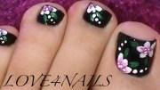 black toe nails flower design
