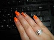 neon orange with daisy - nail art