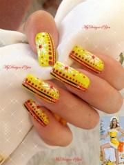 unusual yellow christmas nail art