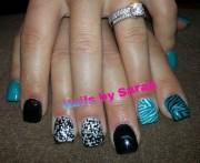 teal polka dot and black - nail