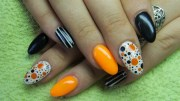 orange black and white nails