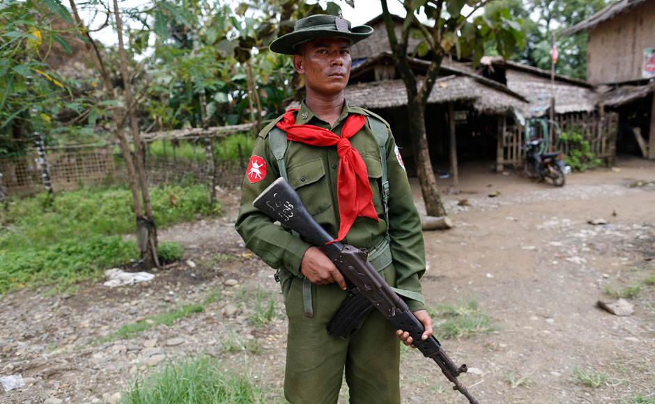 A soldier stands guard near Muslim homes at Shwe Lay village, outside of Thandwe in the Rakhine state, October 2, 2013. Security forces raced to contain deadly violence in Myanmar's Rakhine state on Tuesday, police said, after mobs torched Muslim homes and Buddhist villagers were attacked in a region plagued by intractable sectarian tensions. According to the police, at least five Muslims have died in the violence. REUTERS/Soe Zeya Tun