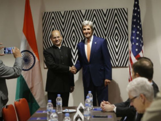 Secretary of State John Kerry, centre-right, shakes hands with India's Minister of Environment, Forest and Climate Change Shri Anil Madhav Dave