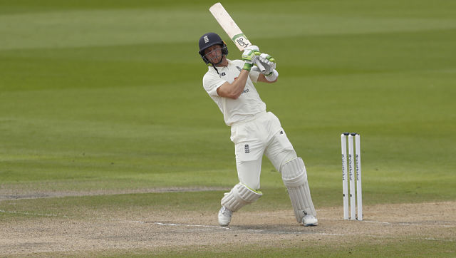 England's Jos Buttler bats during the fourth day of the first cricket Test match between England and Pakistan at Old Trafford in Manchester, England, Saturday, Aug. 8, 2020. (Lee Smith/Pool via AP)