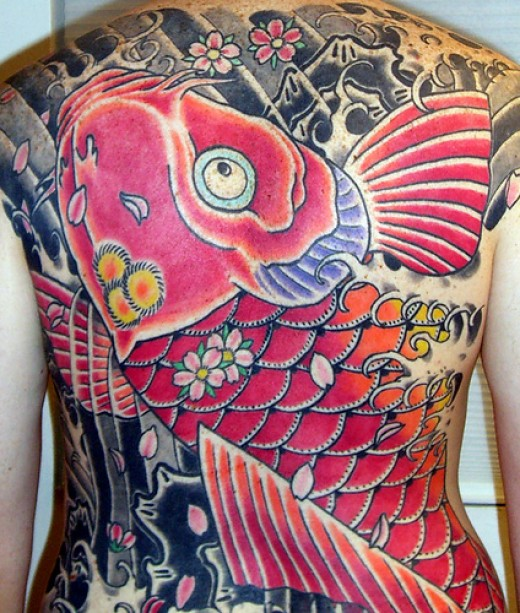 Jeeeez if yer gonna get a fish tattoo on yer back then this huge koi tattoo