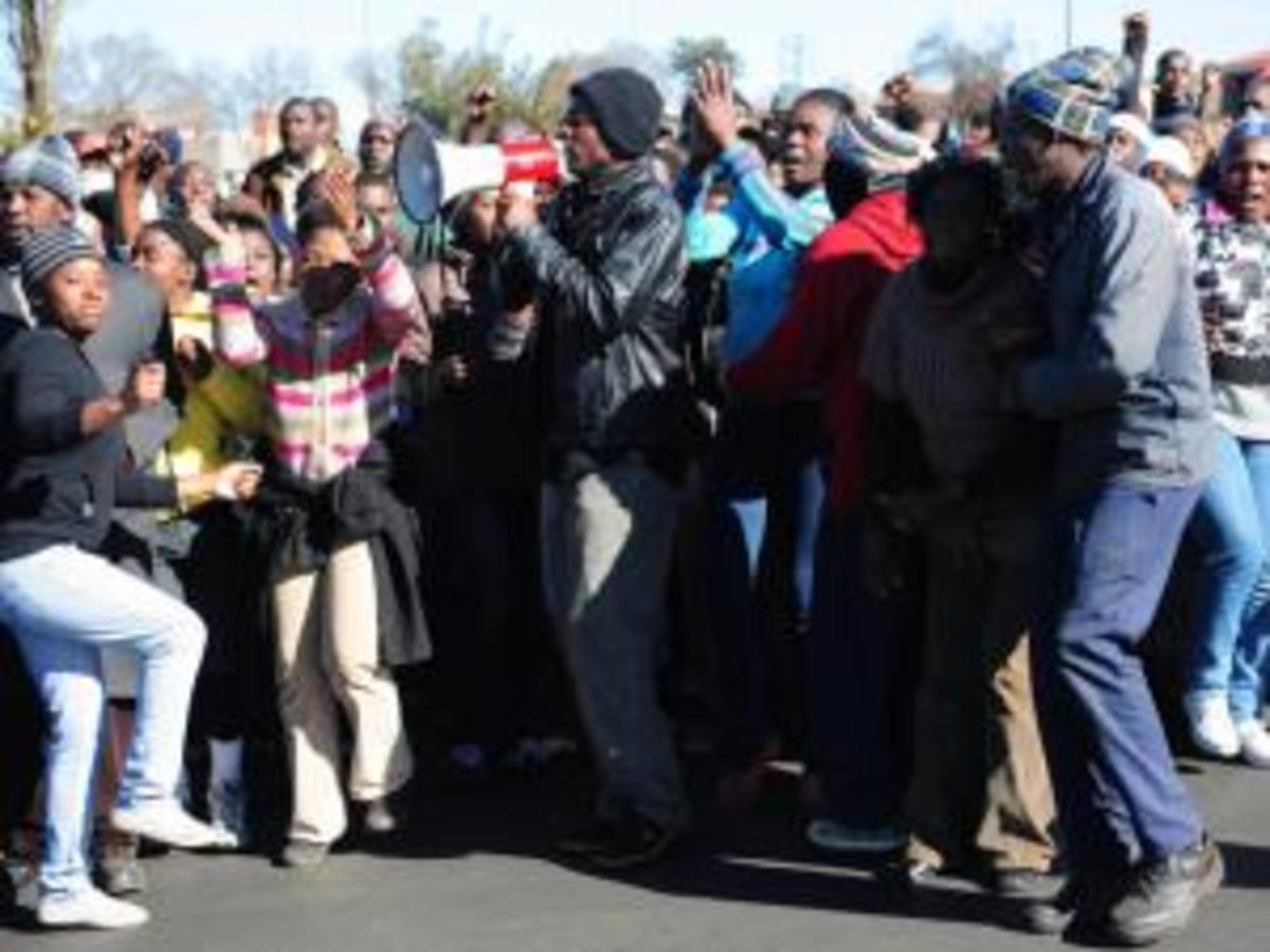 Angry Chiawelo residents protesting outside Moroka Police Station in Soweto After two houses belonging to the councillor and form councillor of Chiawelo were burnt down by angry Chiawelo residents