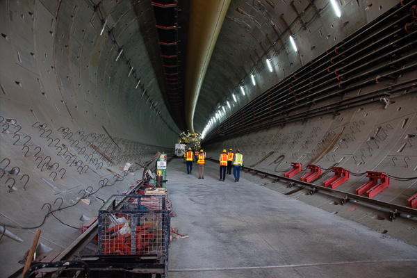 Walking along the tunnel to get to the digging machine at the other end.