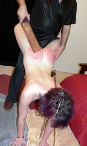 inserting butt plug and a getting a spanking