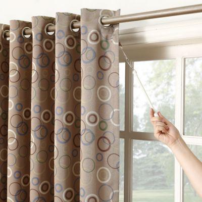 https www bedbathandbeyond com amp store product sun zero 84 inch grommet top room darkening patio window curtain panel in taupe 1047289963