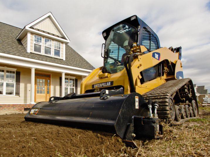 cat landscaping equipment snow