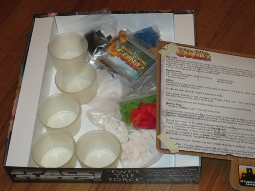 What comes in the box for Going, Going, GONE! Five cups, 240 cubes, 49 cards, an auction paddle, and some chits. (Unfortunately, the other pictures I took of the cups didn't turn out. I'll upload those later.)