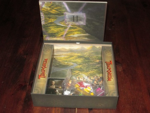 The components in Temporum are...a little sparse. Some cards, wooden pieces, and money tokens. They don't take up much space in the box, and the board is smaller than the box dimensions and shifts around. The insert looks nice, though. All told, a somewhat disappointing package.