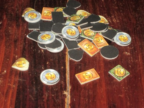 The money tokens in Temporum are thematic, advancing through time as they advance through denominations, but they are one-sided, which is disappointing.