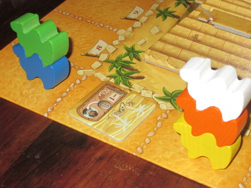 Oasis/desert tiles let players manipulate the race to get their camels on top [!].