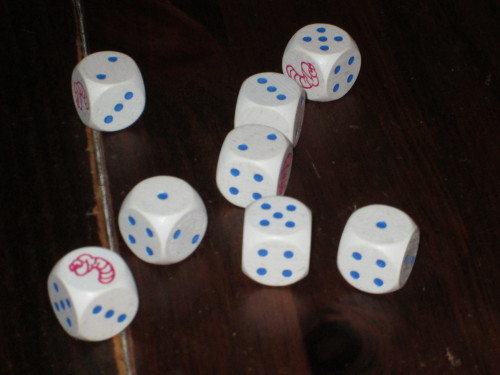 A sample roll. In this example, a player could set aside two 1s, two 2s, one 3, two 5s, or one worm.
