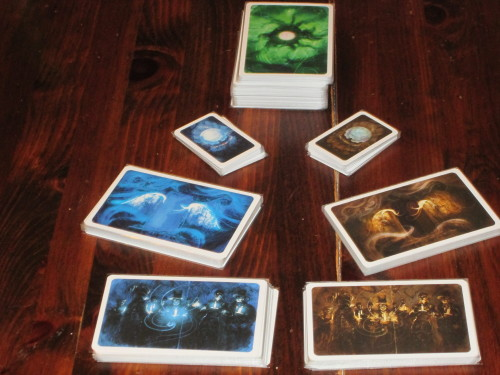 The cards for the game. These are the ghost's dream cards and then the item, location, and character decks. The blue-back cards are for the ghost to use to determine which clues to give to each player.