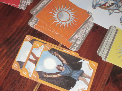 During the card phase of a player's turn, a player may discard a card and draw a card of the same color. These discards give all players information about what cards might be in the deck and might be in other players' hands.