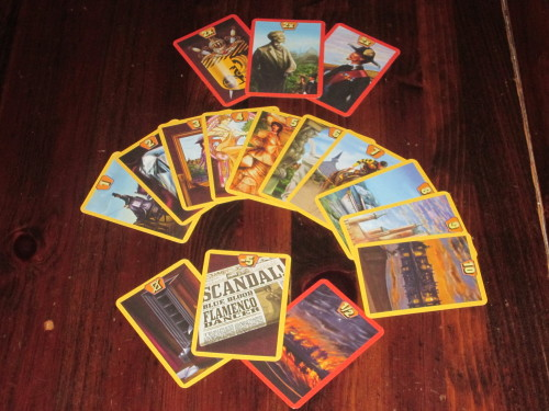 The cards in the auction deck in High Society. The possessions, scandals, and recognition cards provide a good deal of flavor for the game.