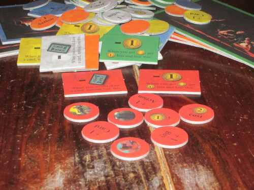 Each player has their own supply of tokens that can modify cards or that provide reminders (like drawing fewer cards or having less money to spend).