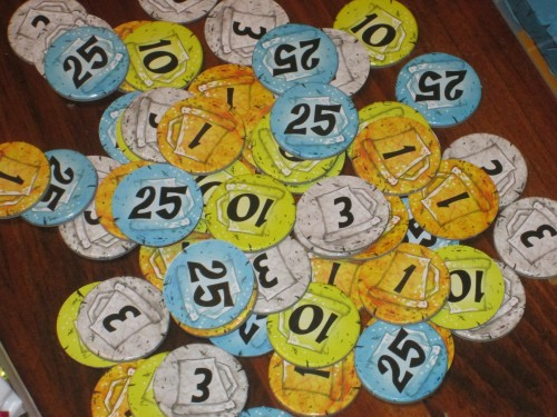 The money tokens in Dwarves Inc.