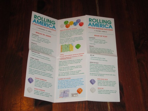 The rules for Rolling America are on a single side of this map-folded paper. English and Spanish rules are included, and the game's components are language independent.