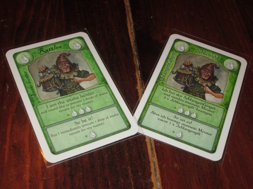 The snake handler card in both English and German. While it might scare fewer people off if my copy were in English, it hasn't been much of a problem since the iconography is clear. I wouldn't be scared off by the German version in this case.