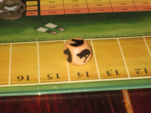 The die in Winner's Circle. Each turn the active player rolls the die and chooses a horse--any horse--to move. This may seem like an innocuous decision, but it can be tense and nasty.