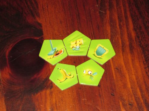 Power up tokens give players advantages...or can hinder opponents who are doing better than you.