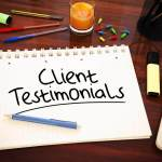Client testimonials written on a notepad for website review