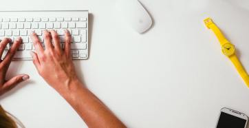 person typing on white wireless keyboard