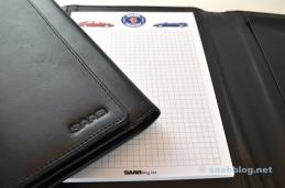 An embossed Saab lettering decorates the cover.