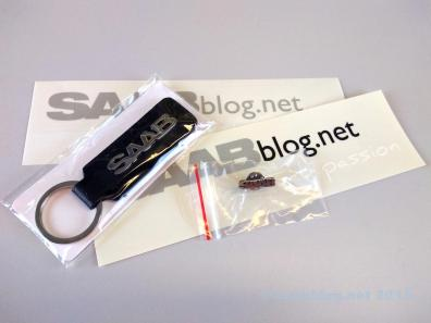 A Saab key chain, pin and stickers are also included