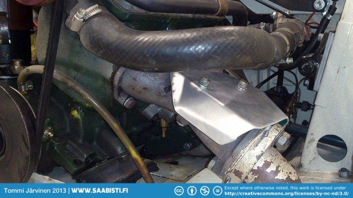 A simple heat shield made of aluminium sheet.