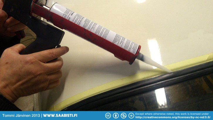 Applying the window sealer.