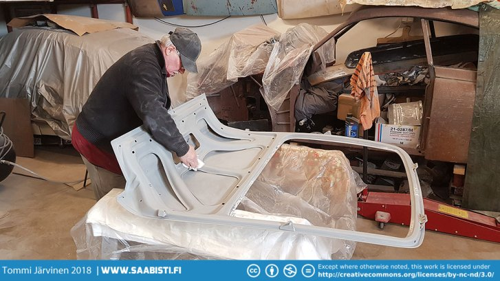 Dad cleaning the hatch for yet another layer of primer.