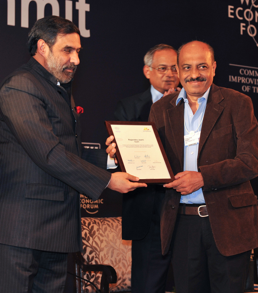 Rajubhai receiving SEY Award