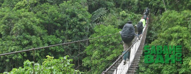 Adventurous jungle trekking along the Crocker Range Mountains in Sabah, Borneo